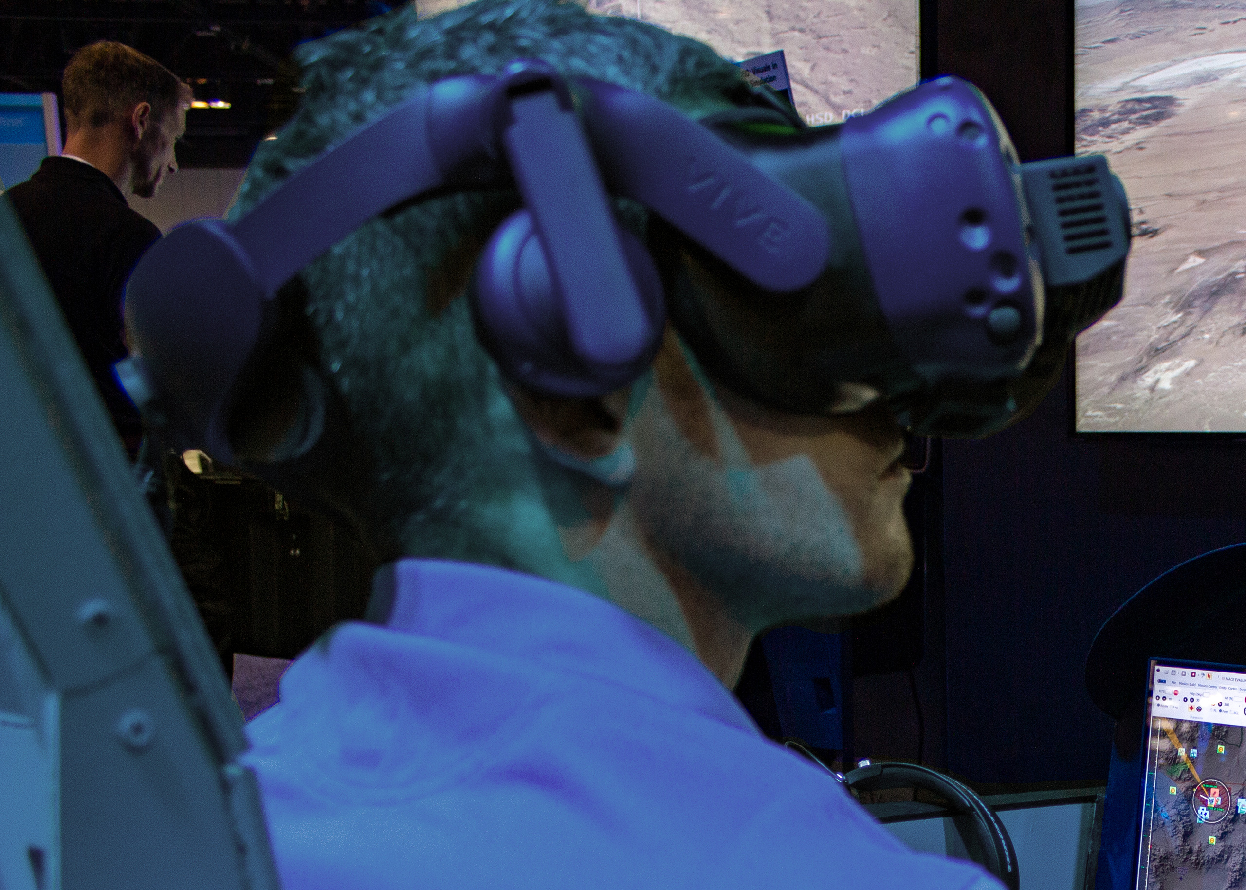 MetaVR's F/A-18 PTMT - The pilot wears the HTC Vive Pro VR system running VRSG, augmented with Collins Aerospace's Coalescence mixed-reality training system.